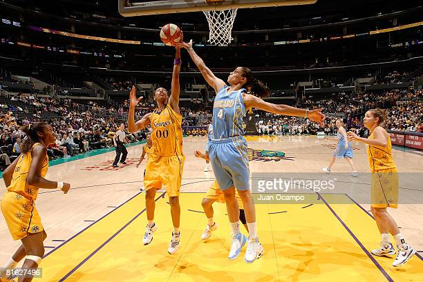 Murriel Page of the Los Angeles Sparks battles for the ball during the game against Candice Dupree of the Chicago Sky on June 18 2008 at Staples...