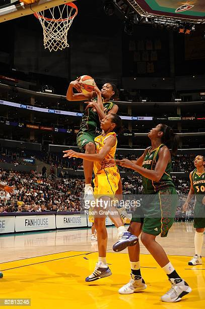 Murriel Page of the Los Angeles Sparks collides with Ashley Robinson of the Seattle Storm on September 14, 2008 at Staples Center in Los Angeles,...