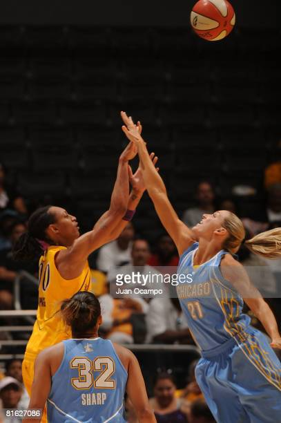 Murriel Page of the Los Angeles Sparks reaches for the ball against Brooke Wyckoff of the Chicago Sky during the game on June 18 2008 at Staples...