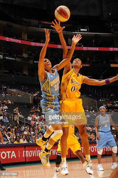 Murriel Page of the Los Angeles Sparks reaches for the ball during the game against Armintie Price of the Chicago Sky on June 18 2008 at Staples...
