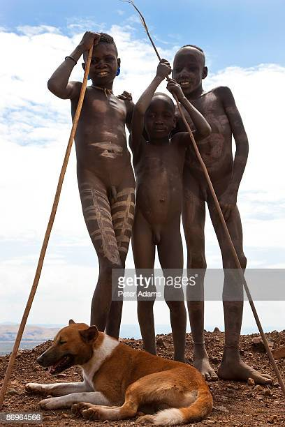 mursi boys, omo valley, ethiopia - only boys stock pictures, royalty-free photos & images