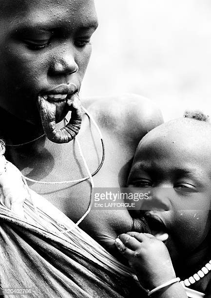 Mursi mother and baby in Omo valley in Ethiopia on October 24 2008 Mursi can be found in the land between the Omo and Mago rivers Neighboured by the...