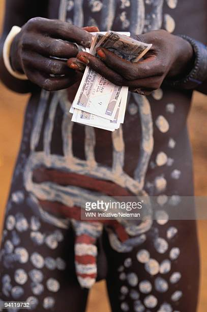 Mursi tribal man counting money