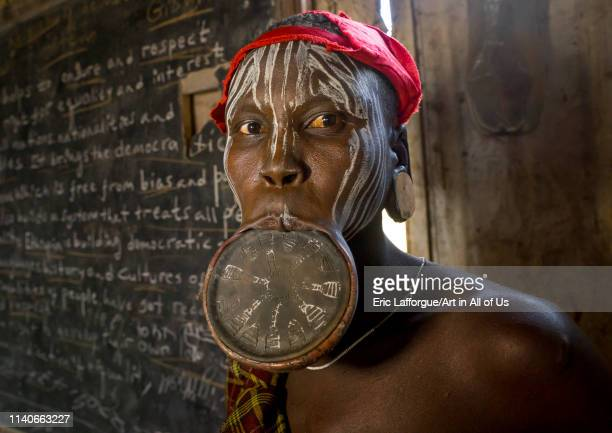 Mursi tribe woman with a huge lip plate Hail wuha village Ethiopia on January 3 2014 in Hail Wuha Ethiopia