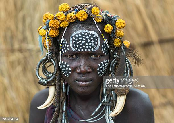 Mursi tribe woman with adornments and tribal make up omo valley mago park Ethiopia on March 18 2016 in Mago Park Ethiopia