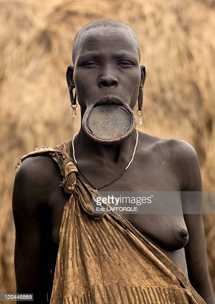 Mursi woman in Omo valley in Ethiopia on October 24 2008 Mursi can be found in the land between the Omo and Mago rivers Neighboured by the Burma Ari...