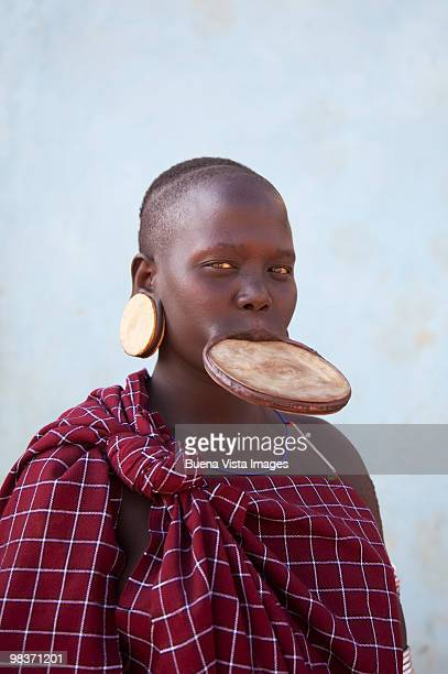 mursi woman with clay lip plate - mursi tribe stock pictures, royalty-free photos & images