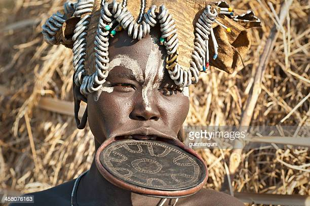 mursi woman with traditional lip plate in southern ethiopia - lip plate stock photos and pictures