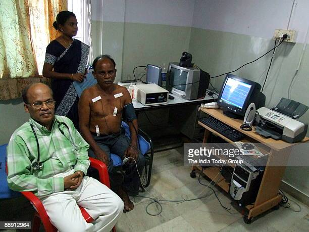 Murugappan with a telemedicine patient at his hospital in Tiruvallur in Chennai India