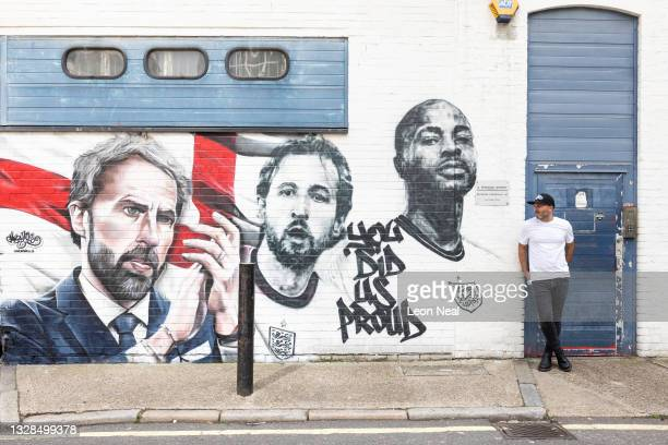 Murwalls owner Marc SIlver poses for a photo next to a new mural honouring members of the England football team, on July 13, 2021 in London, England....