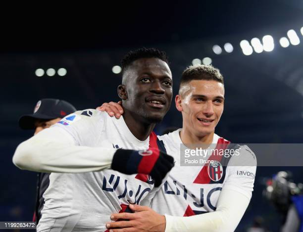 Musa Barrow and Nicolas Dominguez of Bologna FC celebrate the victory after the Serie A match between AS Roma and Bologna FC at Stadio Olimpico on...