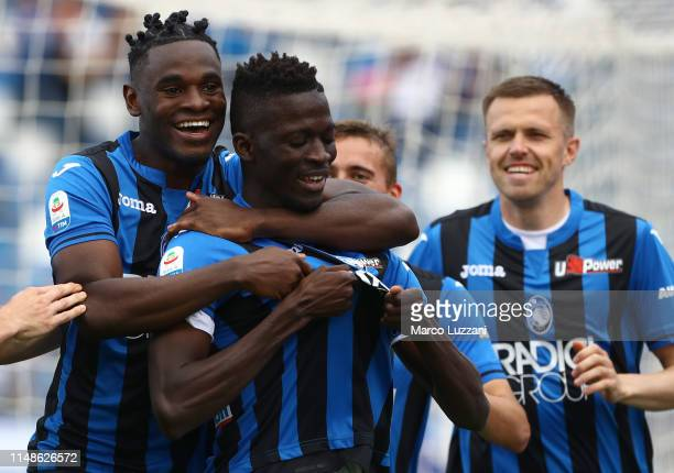 Musa Barrow of Atalanta BC celebrates with his teammate Duvan Zapata after scoring the opening goal during the Serie A match between Atalanta BC and...