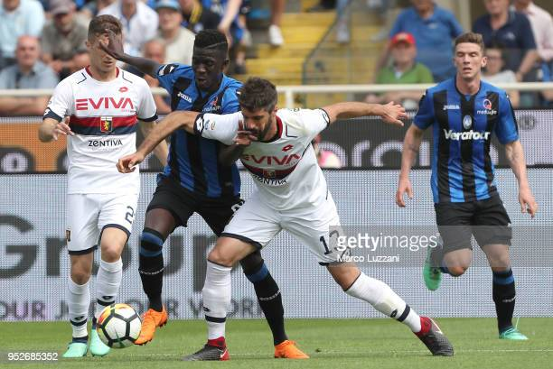 Musa Barrow of Atalanta BC competes for the ball with Luca Rossettini of Genoa CFC during the serie A match between Atalanta BC and Genoa CFC at...
