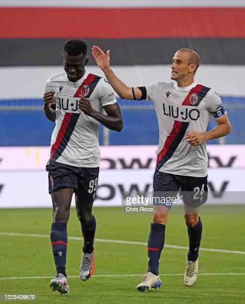 Musa Barrow of Bologna FC celebrates goal with teammate Rodrigo Palacio of Bologna FC during the Serie A match between UC Sampdoria and Bologna FC at...