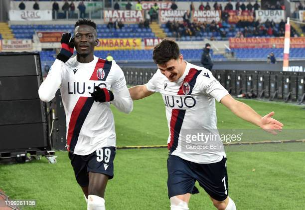 Musa Barrow of Bologna FC celebrates with his teammate Riccardo Orsolini after scoring goal 13 during the Serie A match between AS Roma and Bologna...
