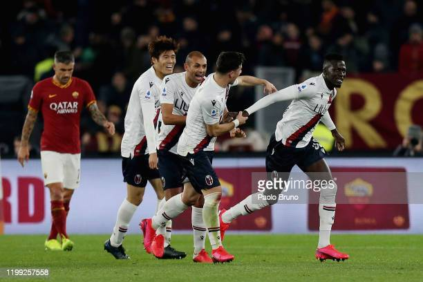 Musa Barrow of Bologna FC celebrates with teammate Riccardo Orsolini after scoring the team's second goal during the Serie A match between AS Roma...