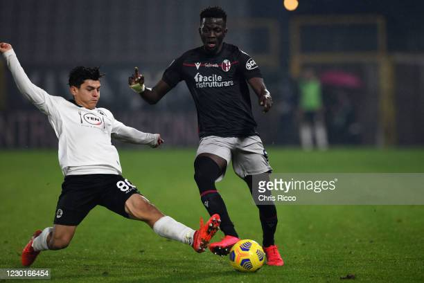 Musa Barrow of Bologna FC tackled by Kevin Agudelo of Spezia Calcio during the Serie A match between Spezia Calcio and Bologna FC at Stadio Alberto...