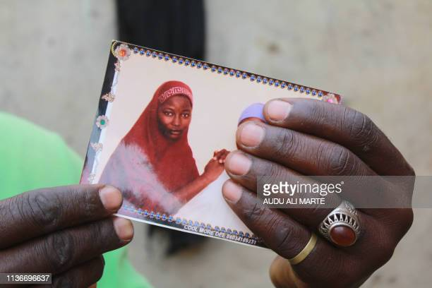 Musa Maina holds a picture of her kidnapped daughter, Hauwa, on April 12, 2019 in Chibok. - In February 2018, the group Boko Haram seized 110...