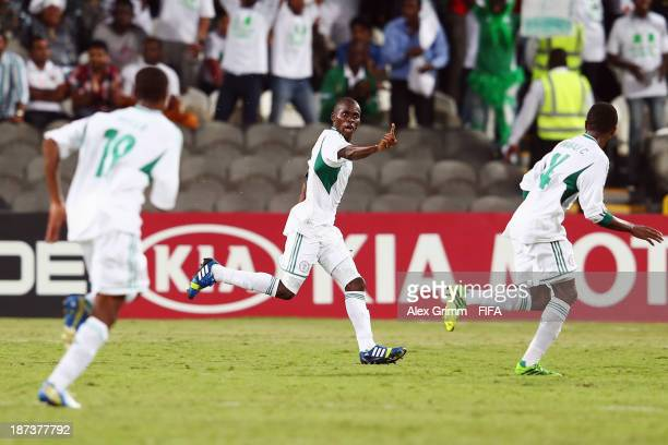 Musa Muhammed of Nigeria celebrates his team's third goal with team mates Taiwo Awoniyi and Chidiebere Nwakali during the FIFA U17 World Cup UAE 2013...
