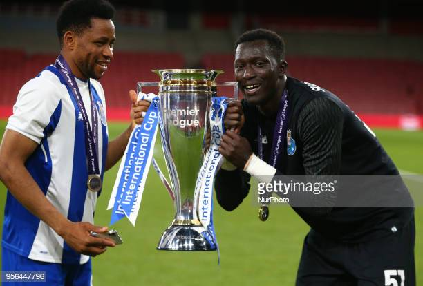 LR Musa Yahaya and Mouhamed Mbaye of Porto FC with Trophy After Premier League International Cup Final match between Arsenal Under 23 against Porto...