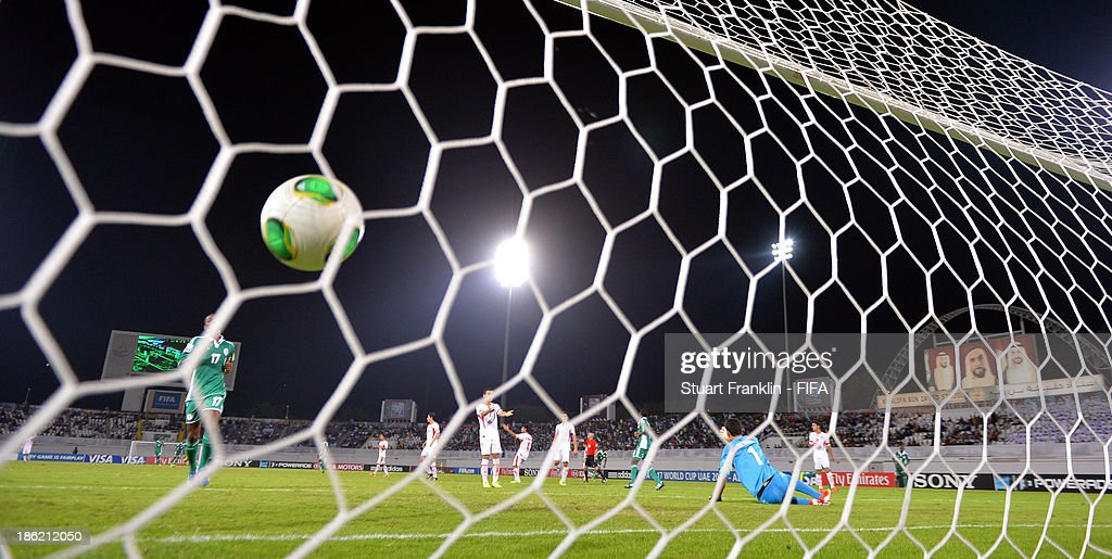 Musa Yahaya of Nigeria scores his goal during the round of 16 match between Nigeria and Iran at Khalifa Bin Zayed Stadium on October 29, 2013 in Al Ain, United Arab Emirates.