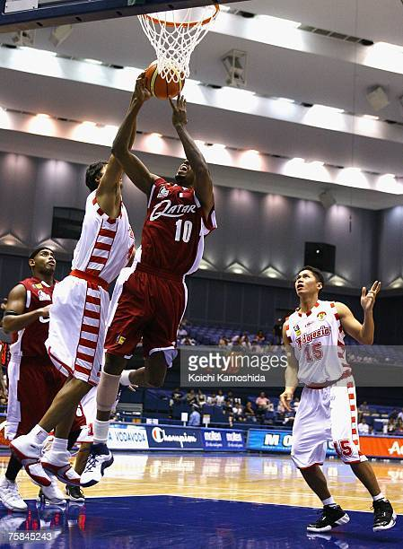Musa Yasseen of Qatar shoots against Indonesia during the 2007 FIBA Asia Championship first round game at Asty Tokushima July 29 2007 in Tokushima...