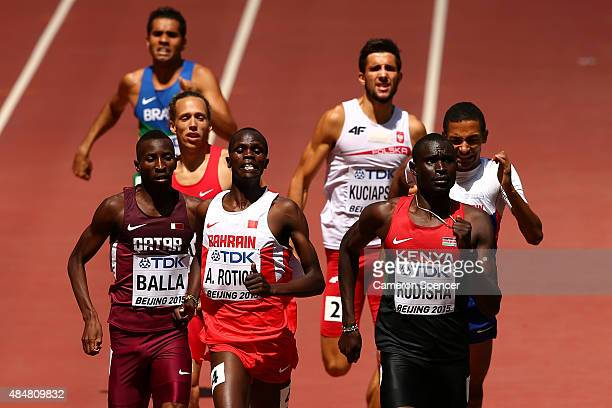 Musaeb Abdulrahman Balla of Qatar, Abraham Kipchirchir Rotich of Bahrain and David Lekuta Rudisha of Kenya cross the finish line in the Men's 800...