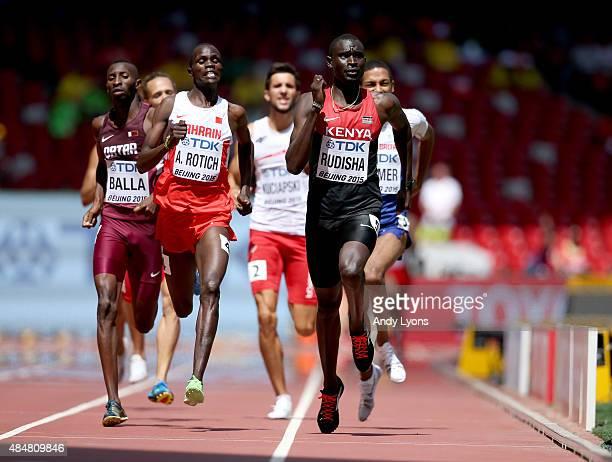 Musaeb Abdulrahman Balla of Qatar Abraham Kipchirchir Rotich of Bahrain and David Lekuta Rudisha of Kenya cross the finish line in the Men's 800...
