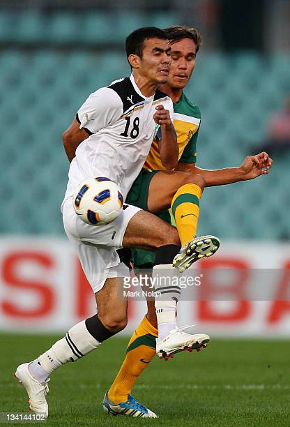 Musaev Fozil of Uzbekistan and James Brown of Australia contest possession during the 2012 Olympic Games Asian Qualifier Third Round match between...