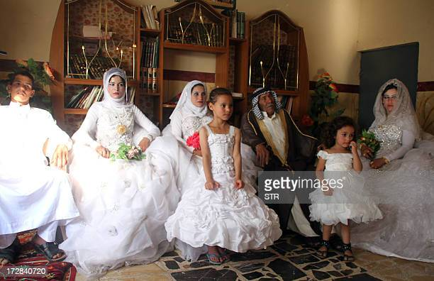 Musali Mohammed al-Mujamaie a 92-year old Iraqi farmer sits next to Muna Mukhlif al-Juburi , his new 22-year old wife, the wives of his grandsons and...