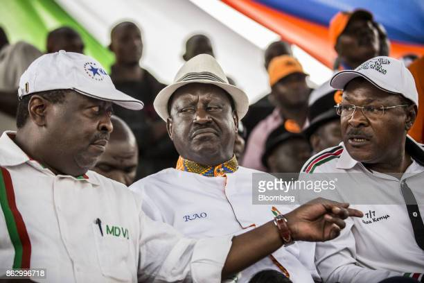 Musalia Mudavadi principal of the National Super Alliance left speaks with Raila Odinga opposition leader for the National Super Alliance center and...
