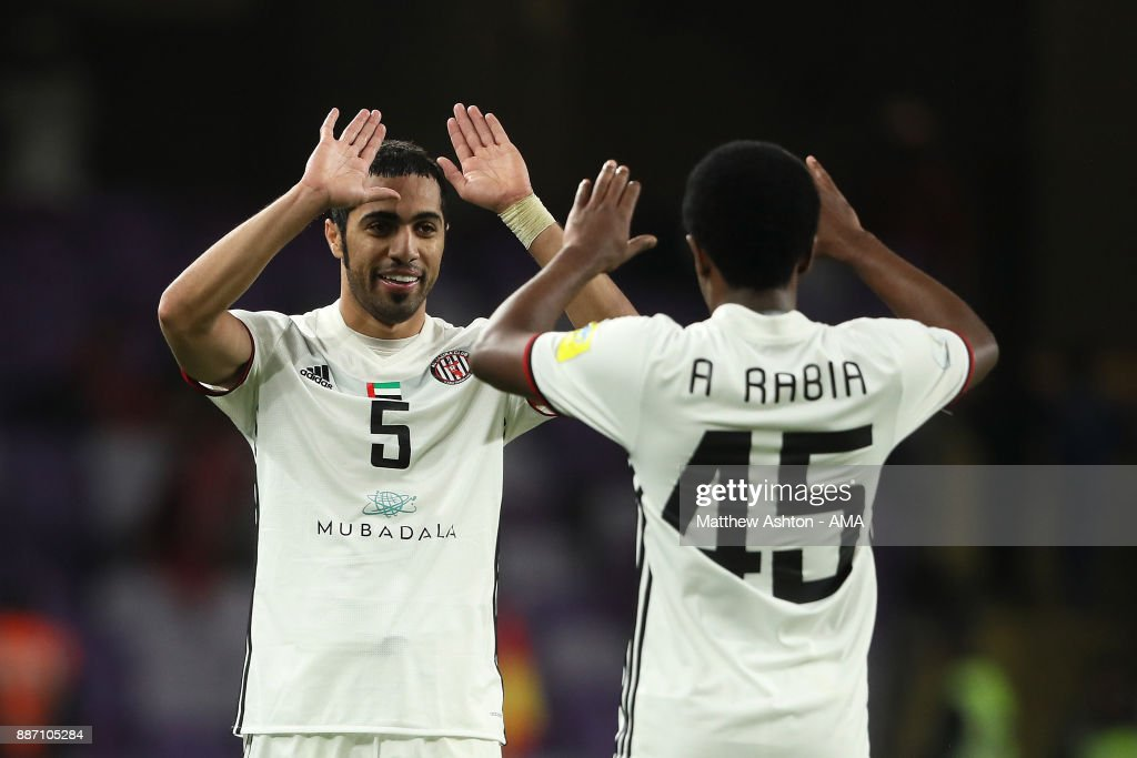 Musallem Fayez and Ahmed Rabia of Al Jazira celebrate at the end of the FIFA Club World Cup UAE 2017 play off match between Al Jazira and Auckland City FC at Hazza bin Zayed Stadium on December 6, 2017 in Al Ain, United Arab Emirates.