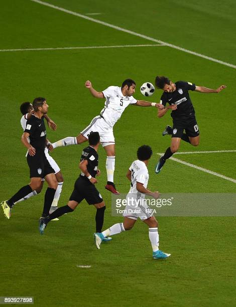 Musallem Fayez of Al Jazira and Raul Lopez of Pachuca jump to the ball during the FIFA Club World Cup UAE 2017 third place match between Al Jazira...