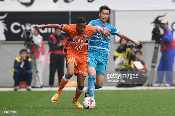 Musashi Suzuki of Albirex Niigata and Daichi Kamada of Sagan Tosu compete for the ball during the JLeague J1 match between Sagan Tosu and Albirex...