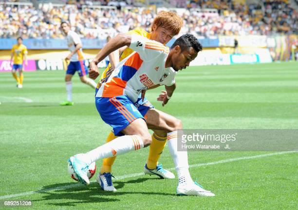 Musashi Suzuki of Albirex Niigata controls the ball under pressure of Yasuhiro Hiraoka of Vegalta Sendai during the JLeague J1 match between Vegalta...