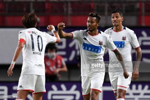 Musashi Suzuki of Consadole Sapporo celebrates scoring his side's first goal during the J.League Meiji Yasuda J1 match between Kashima Antlers and...
