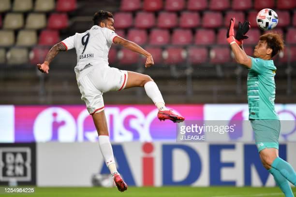Musashi Suzuki of Consadole Sapporo scores his side's first goal past Kwoun Sun Tae of Kashima Antlers during the J.League Meiji Yasuda J1 match...