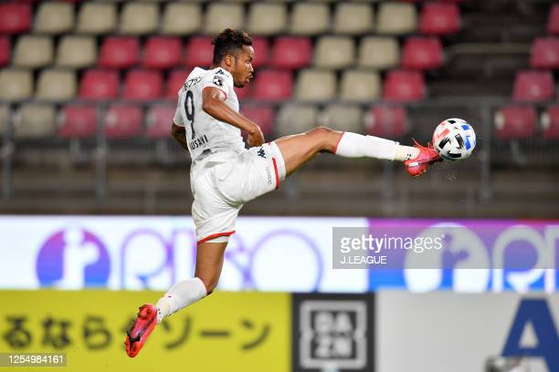 Musashi Suzuki of Consadole Sapporo scores his side's first goal during the J.League Meiji Yasuda J1 match between Kashima Antlers and Consadole...