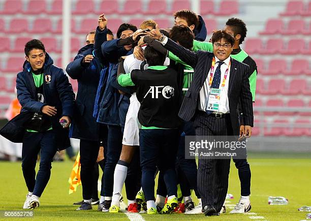 Musashi Suzuki of Japan celebrates scoring his team's first goal with his team mates during the AFC U23 Championship Group B match between Thailand...