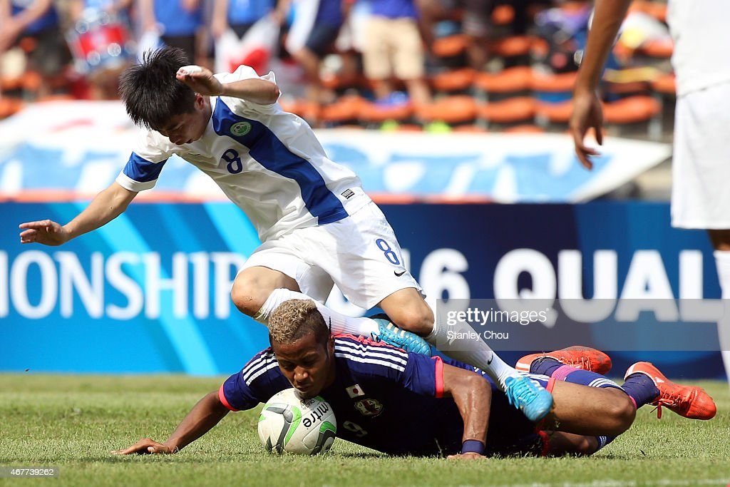 Musashi Suzuki of Japan clashes with Tang Hoi Fai of Macau during the AFC U23 Championship Qualifier Group I match between Japan and Macau at Shah Alam Stadium on March 27, 2015 in Shah Alam, Malaysia.