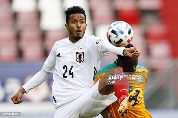 Musashi Suzuki of Japan, Odilon Kossounou or Ivory Coast during the friendly match between Japan and Ivory Coast at Stadium Galgenwaard on October...