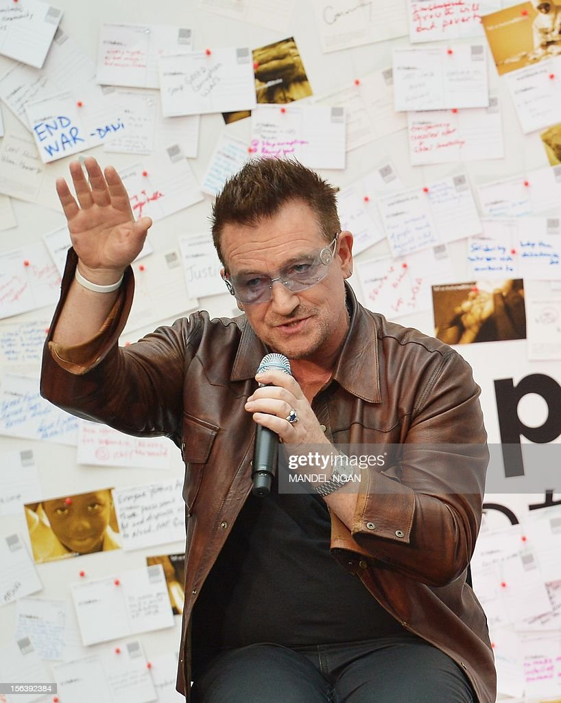 Muscian and activist Bono speaks during a discussion on ending poverty on November 14, 2012 in the atrium of the World Bank Headquarters in Washington, DC. AFP PHOTO/Mandel NGAN