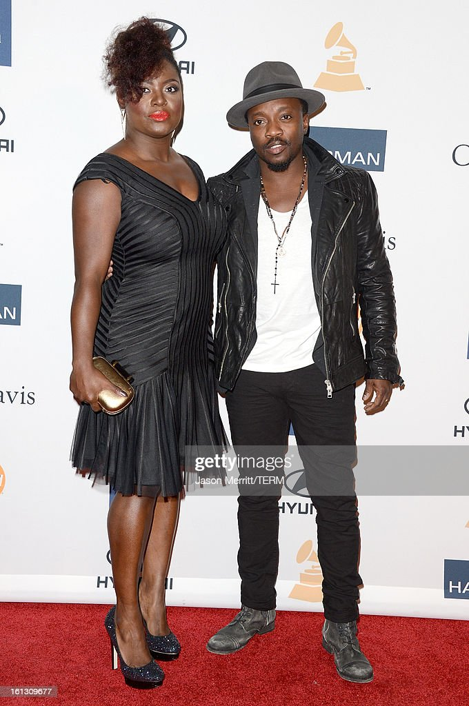 Muscician Will.i.am (L) and guest arrive at Clive Davis & The Recording Academy's 2013 Pre-GRAMMY Gala and Salute to Industry Icons honoring Antonio 'L.A.' Reid at The Beverly Hilton Hotel on February 9, 2013 in Beverly Hills, California.