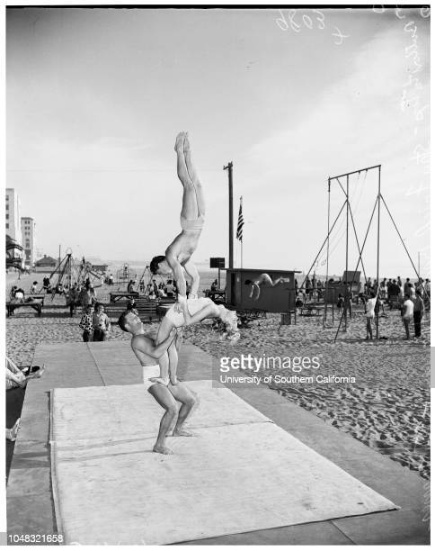 Muscle Beach, 24 January 1953. Chet Mastin;Barbara thomason -- 16 years;Stan Fried;Stan Turner.;Caption slip reads: 'Photographer: Sandusky. Date: ....