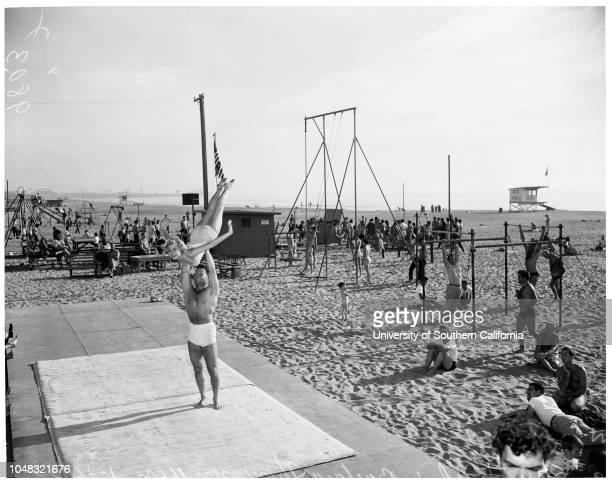 Muscle Beach 24 January 1953 Chet MastinBarbara thomason 16 yearsStan FriedStan TurnerCaption slip reads 'Photographer Sandusky Date Assignment Beach...