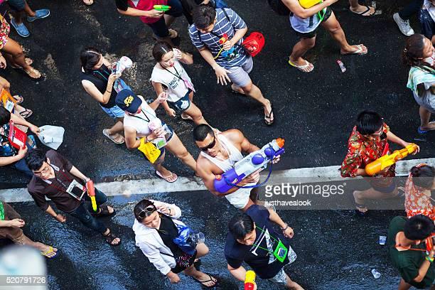 Muscled thai man with big water gun