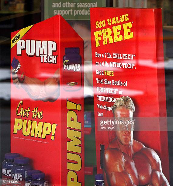 A muscleman ad for PumpTech is seen in the window of a General Nutrition Centers store March 17 2005 in Morton Grove Illinois Athletes and...