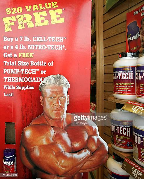 A muscleman advertisement lies in the window of a General Nutrition Centers store March 17 2005 in Morton Grove Illinois Stores such as GNC sells...