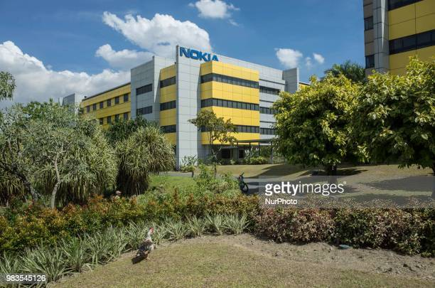 A muscovy duck is seen outside the Philippines office of Nokia at an information technology hub in Manila Philippines 29 May 2018 Singaporean mobile...