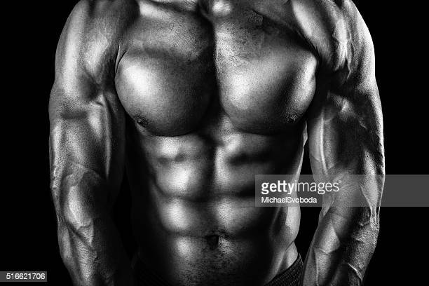 muscular african american man in black and white - male torso stock photos and pictures